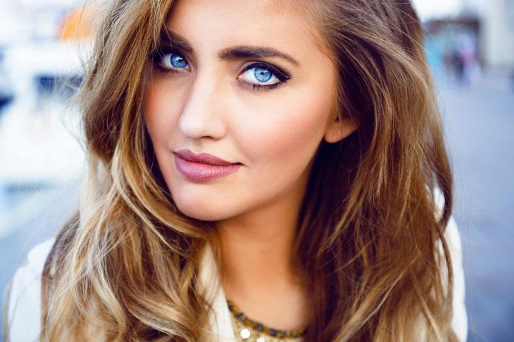 seductive sexy woman with big blue eyes